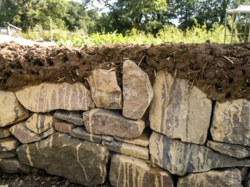 Detail of the dry-stone wall base (no cement used!) with the first layer of cob on top - the sculpture will be created using almost entirely natural materials, the only exception is the water-proof membrane on the roof