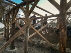 Simon and Jakob putting the rafters on. Timber frame land art sculpture
