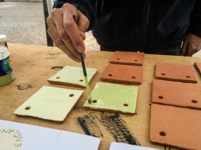LandWorks trainee painting tiles