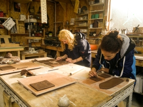 Plymouth University students Megan and Hannah (and Paige who isn't in the picture) making clay tiles